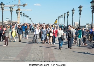 Moscow, Russia-May 27,2018: Patriarshy Bridge bridge full of people spanning Moskva River and Vodootvodny Canal.