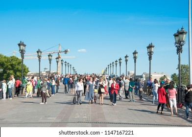 Moscow, Russia-May 27,2018: Patriarshy Bridge bridge full of locals and tourists spanning Moskva River and Vodootvodny Canal.