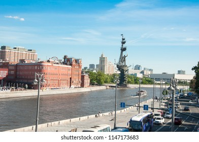 Moscow, Russia-May 27,2018: Prechistenskaya Naberezhnaya from Patriarshy Bridge with Peter the Great Statue monument  in the distance.