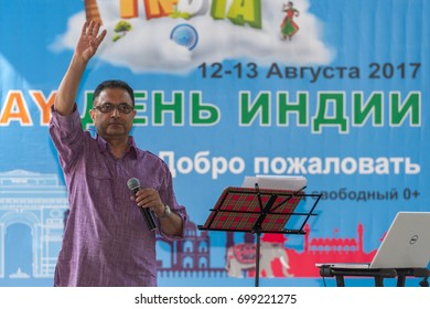 MOSCOW, RUSSIAN FEDERATION - AUGUST 13, 2017: Actor in a festive costume perform a song. Main stage, advertising poster as background. India Day, Sokolniki park.