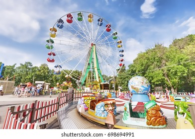 Moscow, Russian Federation - August 2, 2017:  Sokolniki Park with people enjoy the attractions ride park