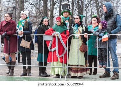 MOSCOW, RUSSIAN FEDERATION - CIRCA MARCH, 2017: St. Patrick's day in Sokolniki park. Audience of parade in memory of St. Patrick in festive clothes with symbols of Ireland.