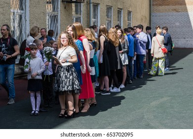 "MOSCOW, RUSSIAN FEDERATION - CIRCA MAY, 2017: ""Last Bell"", the traditional name of the graduation ceremony. School yard. Pupils at the holiday."