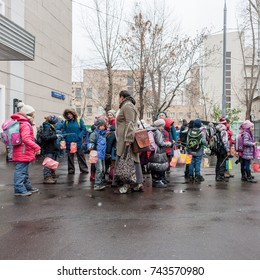 "MOSCOW, RUSSIAN FEDERATION - CIRCA OCTOBER, 2017: ""Holiday of lanterns"". Children, teachers and parents near the school. In the hands of children homemade flashlights. Lyusinovskaya street, 31."