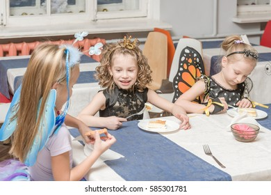 MOSCOW, RUSSIAN FEDERATION - DECEMBER 23, 2016: To reduce anxiety and stress before the performance, children eating breakfast in the school cafeteria in costumes for play.