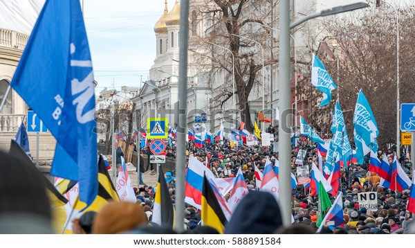 MOSCOW, RUSSIAN FEDERATION - FEBRUARY 26, 2017: Members of the opposition march in memory of Nemtsov. The action, posters and slogans agreed with the authorities.