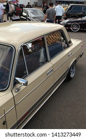 """MOSCOW, RUSSIAN FEDERATION - JUNE 1, 2019: Open automobile festival of Stance culture in """"Podsolnukhi Art&Food"""" center (Moscow city, Russia). Unusual tuning beige Lada car"""