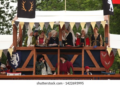"""MOSCOW, RUSSIAN FEDERATION - JUNE 12, 2019: """"Times and Eras"""" festival in Kolomenskoye park. Knightly tournament, historical reenactment of Middle Ages. Knights on horses, fight, great ladies, clowns"""