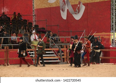 """MOSCOW, RUSSIAN FEDERATION - JUNE 12, 2019: """"Times and Eras"""" festival in Kolomenskoye park. Knightly tournament, historical reenactment of Middle Ages. Knights, fight, great ladies and clowns"""