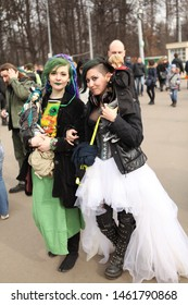MOSCOW, RUSSIAN FEDERATION - MARCH 15, 2014: Annual traditional parade in honor of St. Patrick's Day (Irish national holiday) in Park Sokolniki, Moscow. Girls in subculture style with BJD dolls