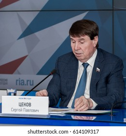 """MOSCOW, RUSSIAN FEDERATION - MARCH 28, 2017: Participant of press conference """"Pilgrimage to the Crimea""""  Mr. Tsekov. Information agency """"Russia Today"""" interior."""