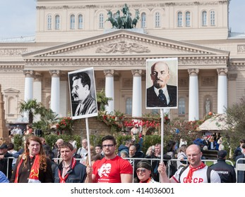 MOSCOW, RUSSIAN FEDERATION - MAY 1: Member of the Communist rally with the symbols of USSR. May 1, 2016, Theater Square, Moscow, Russia.