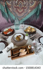 """MOSCOW, RUSSIAN FEDERATION - MAY 20, 2018: Served table in seafood restaurant """"Ryba moya"""" on 1st Tverskaya-Yamskaya Street, 21, Moscow city, Russia. Dishes from chef and restaurant interior"""