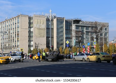 MOSCOW, RUSSIAN FEDERATION - OCTOBER 16, 2019: Incident on Tverskaya Street in Moscow city, Russia. Terrible wreck as result of traffic violation - cars collided and one car turned over, injured