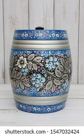 MOSCOW, RUSSIAN FEDERATION – OCTOBER 30, 2019: Ancient russian traditional national handcraft: keg with north khokhloma painting. Vintage wooden ware. Best souvenir from Russia. Russian folk style