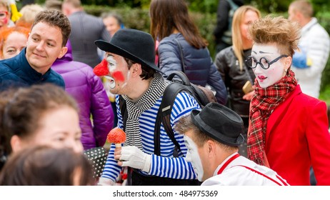 MOSCOW, RUSSIAN FEDERATION - SEPTEMBER 17, 2016: Circus artists are in the crowd of park visitors. Artists draw attention and invite to visit the circus. Clown Fest, Sokolniki park.