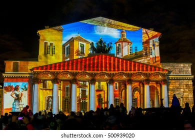 """MOSCOW, RUSSIAN FEDERATION - SEPTEMBER 24, 2016: International festival """"Circle of light"""". Light show on the facade of building of the Bolshoi (Large) Theater.  Theater passage."""