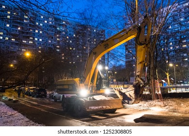 MOSCOW, RUSSIA,NOVEMBER,30.2018:The powerful wheeled excavator JCB company on the streets of the city at night