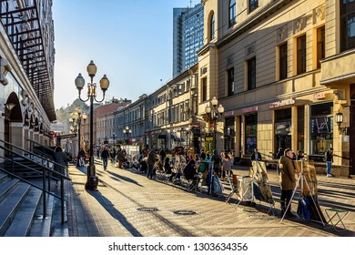 Moscow, Russia-October, 11, 2018: Artists at the beginning of Arbat street at sunset of an autumn sunny day.