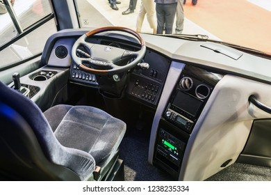 """Moscow, Russia-October 23, 2018: steering wheel and cab of a comfortable intercity or city bus at Busworld Russia 2018"""""""