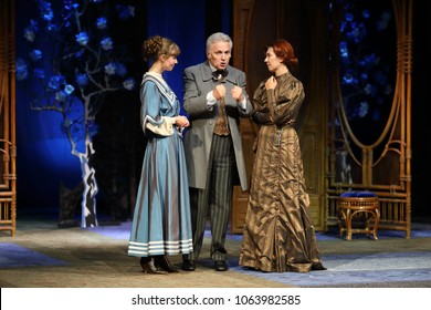 MOSCOW - SEP 14, 2017: The conversation of two young women and men in the play Cherry Orchard on stage at the Moscow Theater Center the Cherry Orchard in September 2017