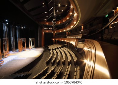 MOSCOW - SEP 14, 2017: Interior of an empty small hall with a stage with scenery and a hall with rows of chairs and balconies in the Moscow Theater Center Cherry Orchard