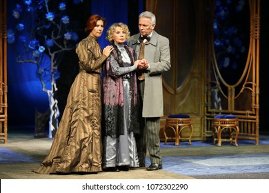 MOSCOW - SEP 14, 2017: Two women and a man in ancient costumes play roles on the stage in Anton Chekhovs play The Cherry Orchard at the Moscow Theater Center the Cherry Orchard in September 2017