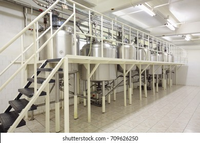 MOSCOW - SEP 15, 2016: Reservoirs in workshop of cosmetics factory Freedom was created on basis of first in Russia perfume factory Rally and Co, which was founded in 1843