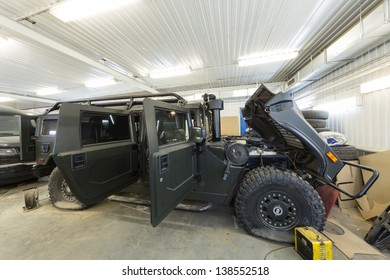 MOSCOW - SEP 21: Large military car is in the repair on car repair shop Avtostandart on September 21, 2012 in Moscow, Russia.