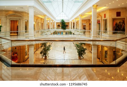 Moscow - Sep 3, 2011: Panoramic view of the luxury store interior. Inside the sumptuous mall in classic style. Panorama of expensive boutiques in shopping center.