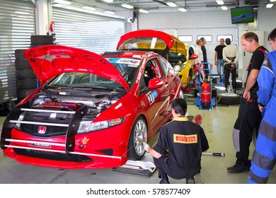 MOSCOW - SEP 3, 2016: Cars repair during Race of Stars At wheel Magazine with participation of best Russian riders at Moscow Raceway