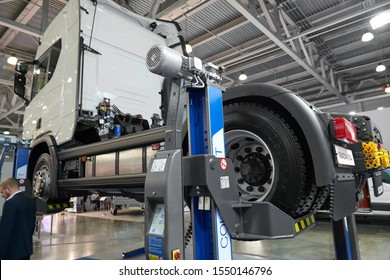 MOSCOW, SEP, 4, 2019: View on commercial truck under maintenance on electric lift. Truck workshop equipment, tools for car and truck chassis maintenance and repair works. Lifted car under inspection