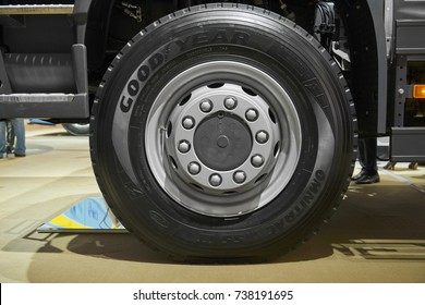 MOSCOW, SEP, 5, 2017: Close up view on Volvo truck front axle wheels and tires. Truck wheel rim. Truck chassis exhibit on Commercial Transport Exhibition ComTrans-2017. New car tires on wheels
