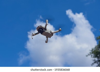 MOSCOW, SEP.3,2020: View on quadcopter drone flying in the blue sky. Remote controled drone with photo video camera