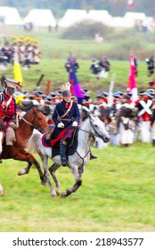 MOSCOW - SEPTEMBER 07, 2014: Reenactors dressed as Napoleonic war soldiers ride horses at Borodino battle historical reenactment.