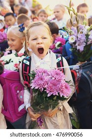 MOSCOW, SEPTEMBER 1, 2016: Unidentified girl yawn on solemn meening of first grade kids, called the Day of Knowledge for pupils, signify the  beginning of school year in Moscow, September 1, 2016