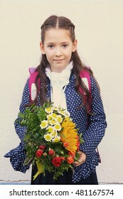 MOSCOW, SEPTEMBER 1, 2016: Unidentified girl with flowers bouquet on solemn meening of first grade kids, called the Day of Knowledge, signify the beginning of school year in Moscow, September 1, 2016