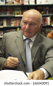 MOSCOW - SEPTEMBER 10: Former mayor of Moscow Yury Luzhkov signs copies of books about Moscow mayors, written by Nadezhda Polunina, in the Moscow House of Books on September 10, 2013 in Moscow.
