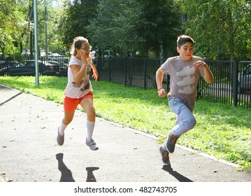 MOSCOW, SEPTEMBER 13, 2016: Unidentified school kids  on outdoor sport sprint running competition in school yard  in Moscow, September 13, 2016