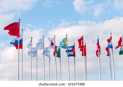 MOSCOW - SEPTEMBER 17: Numerous flags of states on cloudy sky background on September 17, 2014 in Moscow.