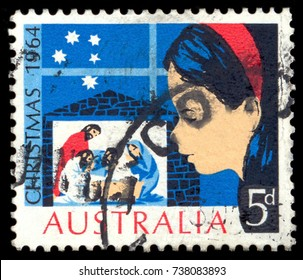 """MOSCOW, September 2, 2017: AUSTRALIA - CIRCA 1964: A stamp printed in Australia from the """"Christmas """" issue shows a child looking at Nativity Scene, circa 1964."""