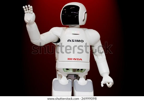 """MOSCOW - SEPTEMBER 2 : Honda 'ASIMO' humanoid robot presented at Moscow international motor show in Moscow, Russia on September 2, 2008. ASIMO stands for """"Advanced Step in Innovative MObility""""."""