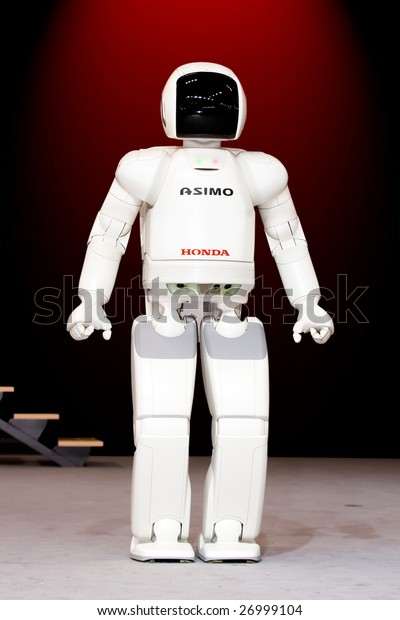 "MOSCOW - SEPTEMBER 2 : Honda 'ASIMO' humanoid robot presented at Moscow international motor show in Moscow, Russia on September 2, 2008. ASIMO stands for ""Advanced Step in Innovative MObility""."
