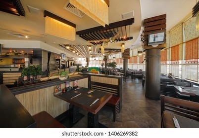 """MOSCOW - SEPTEMBER 2014: The interior of the popular Japanese chain of restaurants in modern style """"YAKITORIYA"""" in Moscow. Hall with wooden furniture"""