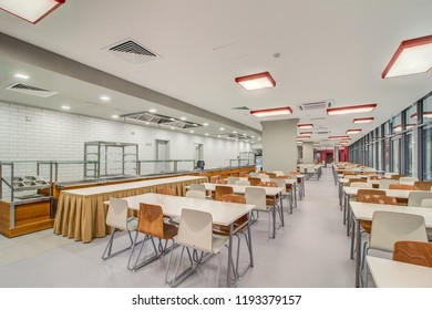 Moscow, September 2018: Modern interior of cafeteria or canteen with chairs and tables, eating room in modern school