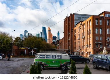 Moscow, September, 2019. View at the  19th century Badaevsky pivzavod; (former industrial brewery currently transformed into business and  leisure area) with the Moscow city on the background.