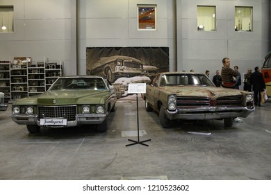 Moscow - September 29, 2012: Cadillac Deville 1972 and Pontiac Catalina 1966 at the international largest exhibition of vintage cars and technical Antiques. Public-event.