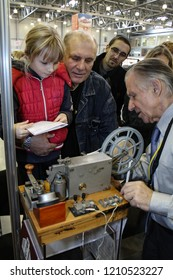 Moscow - September 29, 2012: An old man shows how the old telegraph worked at the international largest exhibition of vintage cars and technical Antiques. Public-event.