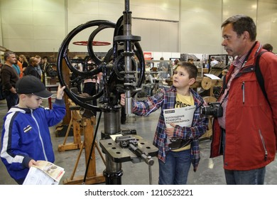 Moscow - September 29, 2012: People watch an old machine at the international largest exhibition of vintage cars and technical Antiques. Public-event.