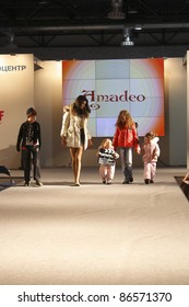 MOSCOW - SEPTEMBER 29: An unidentified model walks down the runway wearing Polish brand Amadeo collection premiere Moscow Kids at  the International Fashion Fair on September 29, 2011  Moscow, Russia.
